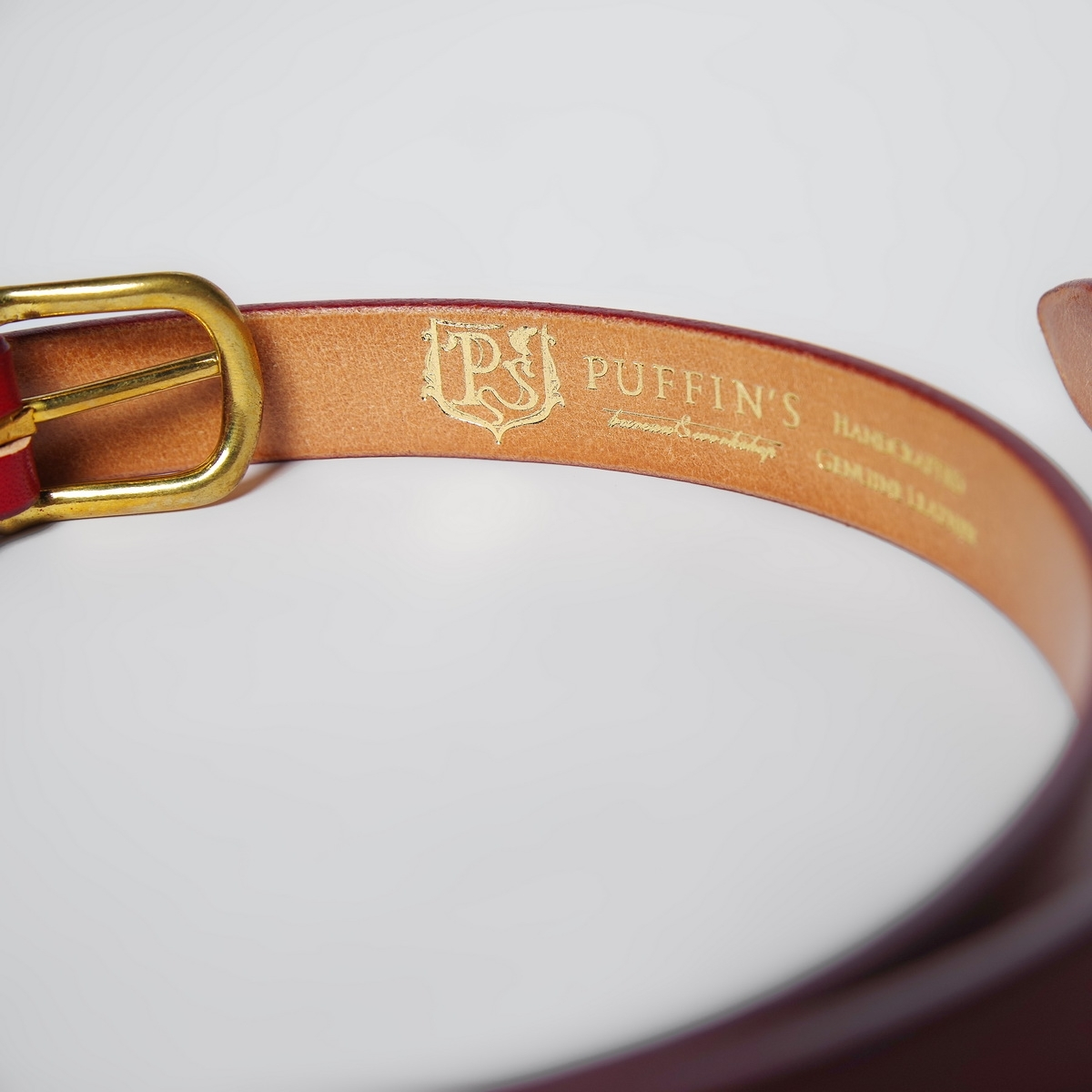 An exquisite 20mm belt with a brass buckle red currant